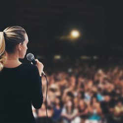 Woman speaking to a crowd